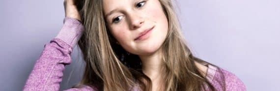 unsure teen girl in purple