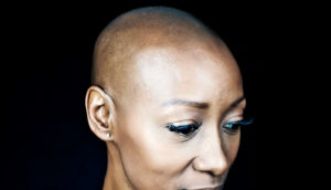 woman against black background (glioblastoma concept)