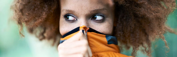 woman covering mouth (bad breath genes concept)
