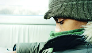 young boy in winter clothes (depression concept)