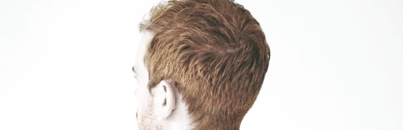 back of redheaded man's head