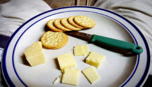 cheese and crackers on plate