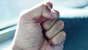 fist on blue