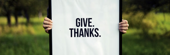 """sign says """"give. thanks."""""""