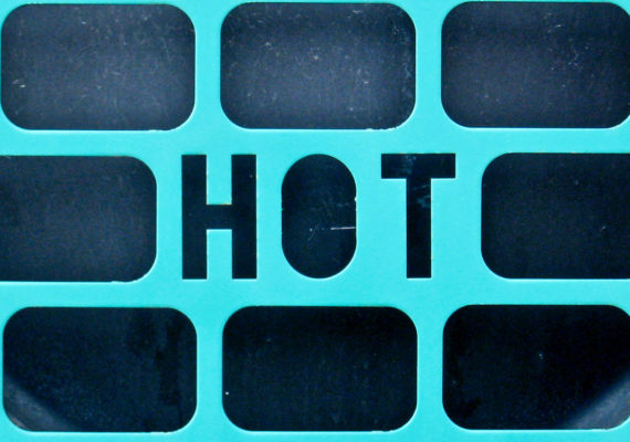 "metal grate with the word ""hot"" in it (rising temperatures concept)"