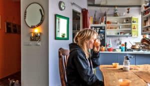 icelander in kitchen drinking from mug