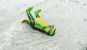 inflatable dinosaur on beach