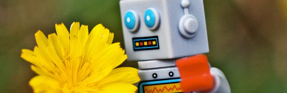 Lego robot smelling flower