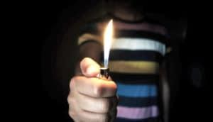lighter held in front of body