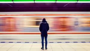 man waiting at subway station