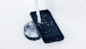 phone under faucet