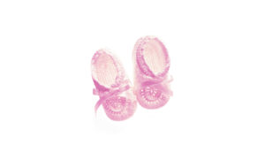 pink baby shoes on white