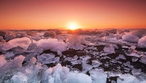 sunrise over ice chunks