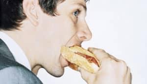 man bites sandwich