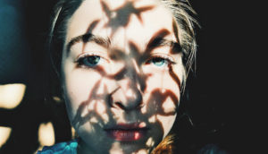 shadows on woman's face and eyes