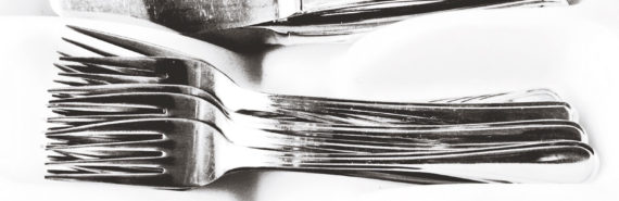 forks and knives on white