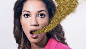 woman with gold glitter coming from mouth