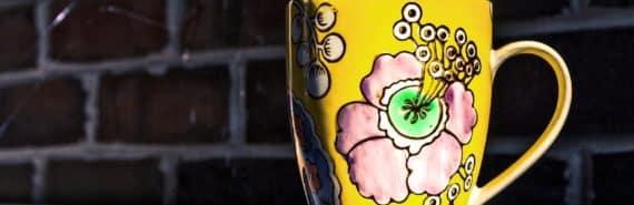 yellow ceramic cup (ceramics concept)