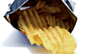 bag of chips on white (food cues and obesity concept)