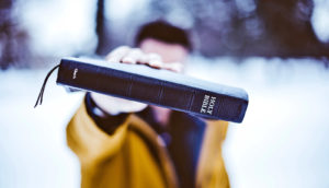 bible held to camera
