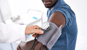 man gets blood pressure check