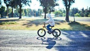 boy on bike (autism concept)