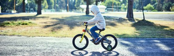 boy on bike (autism concept)