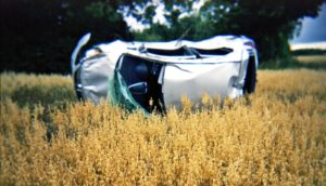 crashed car in field - drivers with dementia