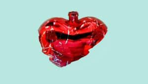 broken glass heart ornament on mint green