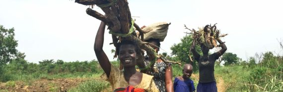 women carrying firewood in Uganda