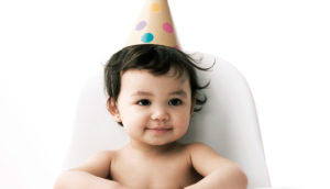 baby in party hat