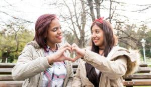 teen lesbian couple in park