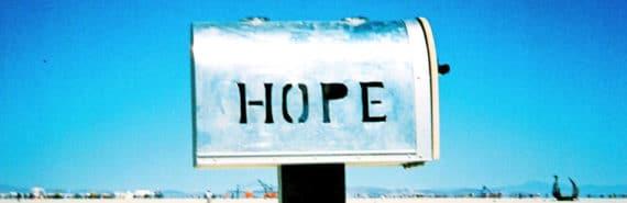 """hope"" written on silver mailbox"