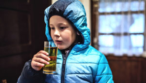 kid sipping beer (alcohol concept)