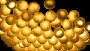 lightbulbs clustered together on black (renewable energy concept)