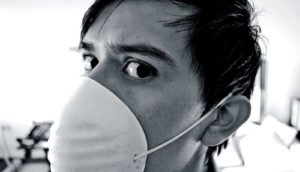 man in medical mask (flu and RIPK3 protein concept)