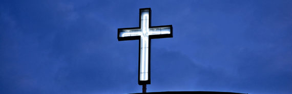 neon cross on church (religion and healing concept)