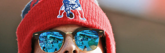 woman in patriots hat and sunglasses