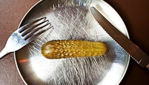 pickle on a metal plate