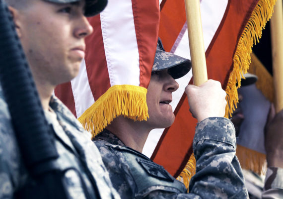 color guard holding flags (US military bases and climate change concept)