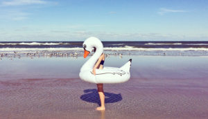 person in swan float at ocean