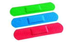 three neon bandaids on white