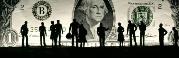 miniature silhouettes in front of dollar