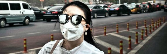 woman in face mask in China (air pollution concept)