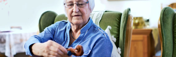 woman tuning violin (dementia concept)