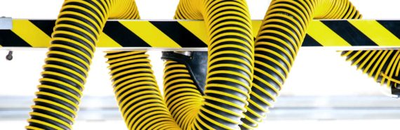 yellow and black tube on warning gate