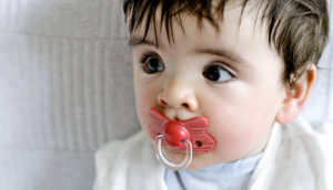 sweaty baby with pacifier