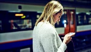 checking news on phone (fake news concept)