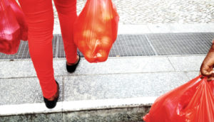 red jeans and red bags of groceries