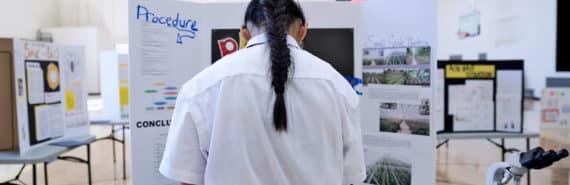 girl facing away at science fair